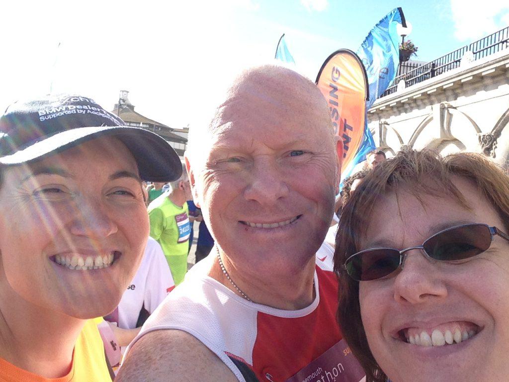 three runners smiling