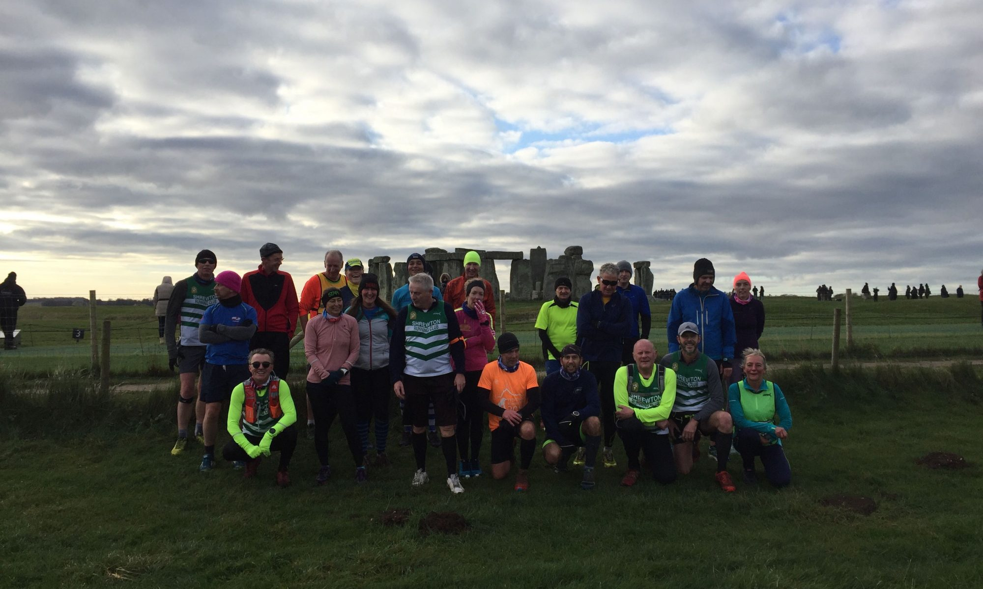 runners in front of stonehenge