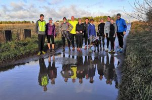 runners reflected in water
